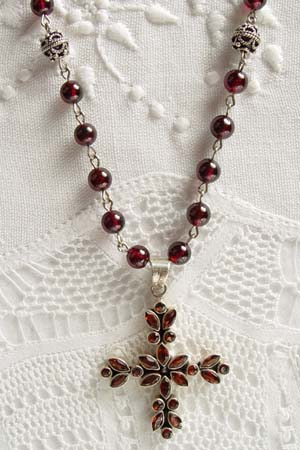 Garnet w 2 in faceted garnet cross